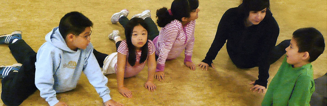 Kids do Cobra with Yoga Instructor ~ Junior Explorers Club