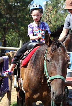 Mira-horseback-riding-at-Summer-Camp