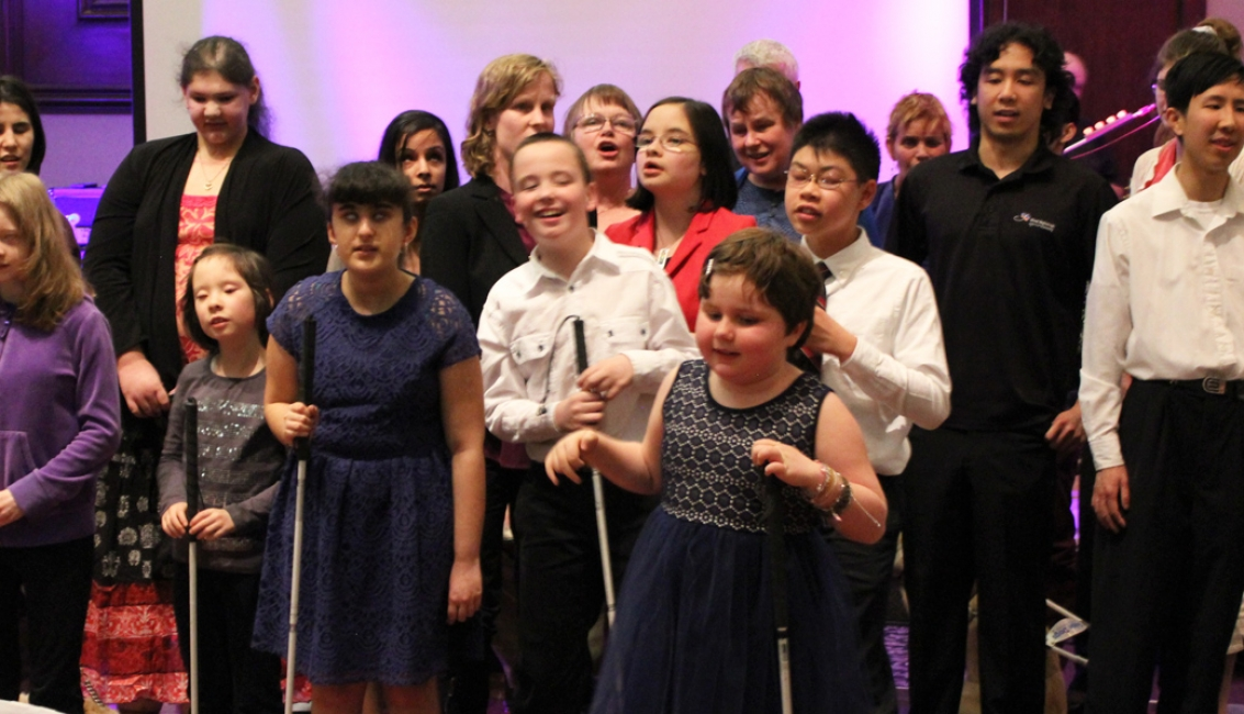 Blind Beginnings Gala group singing I See Differently