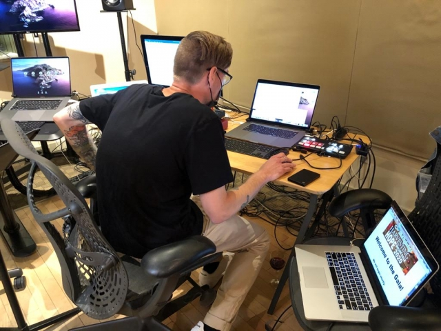 Kent, a volunteer from Descriptive Video Works, is surrounded by three laptops as he works behind the scenes and keeps the Gala running smoothly.
