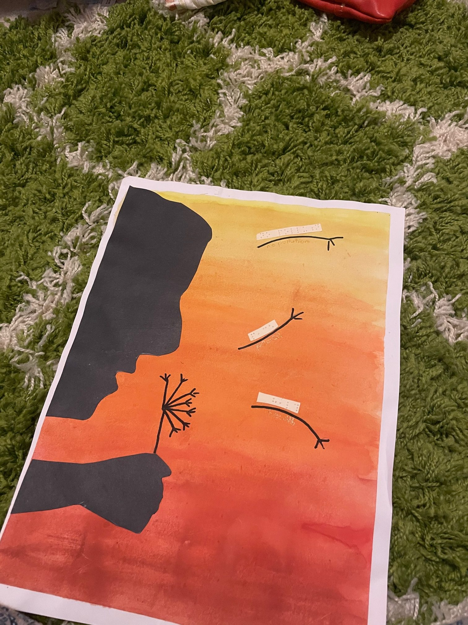 Image of a painting of a silhouette of someone holding a flower, over a background of a watercolour sunset