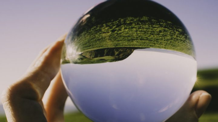 Image o someone looking through a lens that distorts the view and makes it upside down.