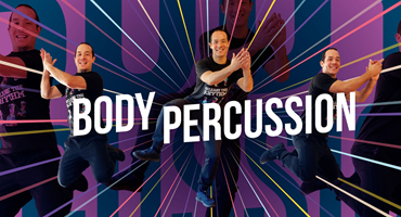 """A smiling man clasp his hands and jumps into the air excitedly, the words """"Body Percussion"""" runs across the image."""