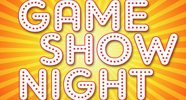 """The words """"Game Show Night"""" are lit up by flashy bright colors."""
