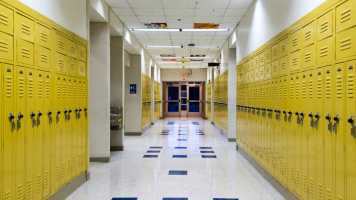 High School hallway showing a line of bright yellow student lockers
