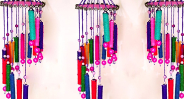 Image of several very colourful homemade wind chimes, made from beads and other crafting materials.